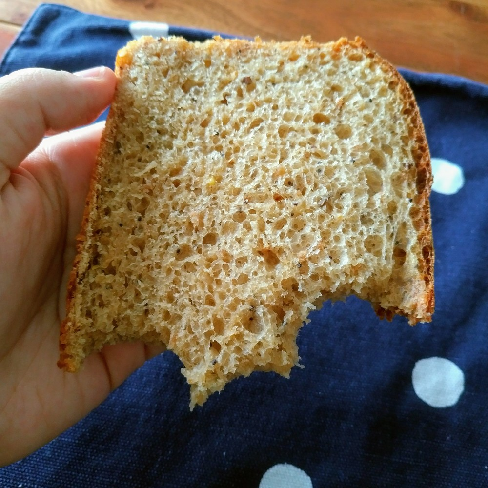 An irresistable slice of bread, revealing little bubbles and seeds